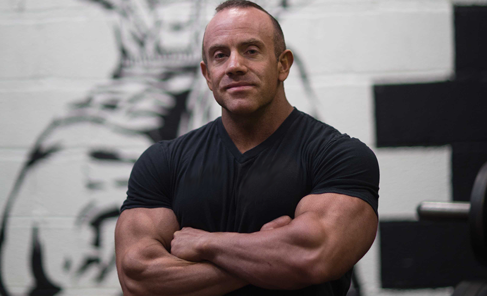 Tom Blackman in arms crossed pose